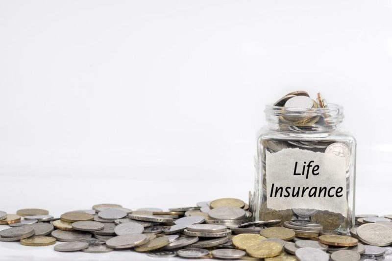 life insurance jar filled with coins