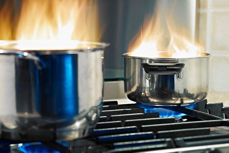 cooking pots on fire