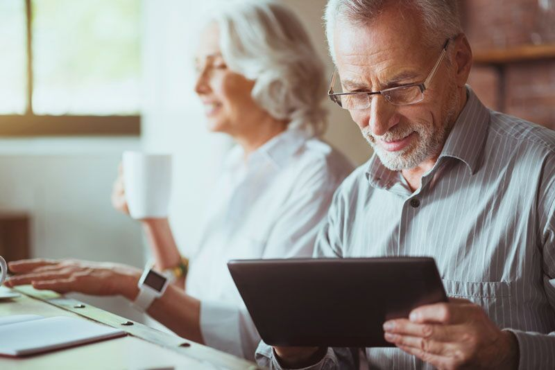 elderly couple considering their life insurance options