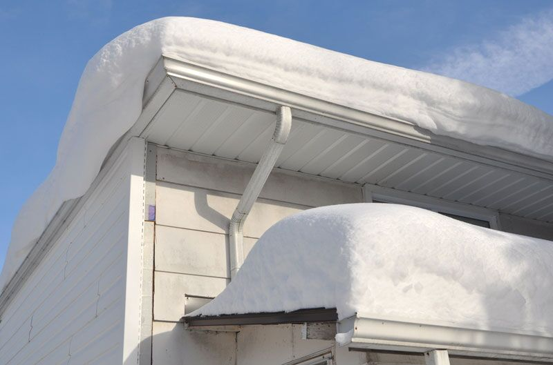 snow on home roof