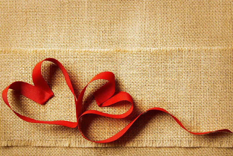 red ribbon in shape of heart