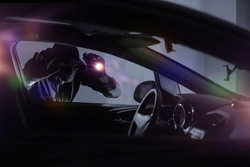 thief targeting a car
